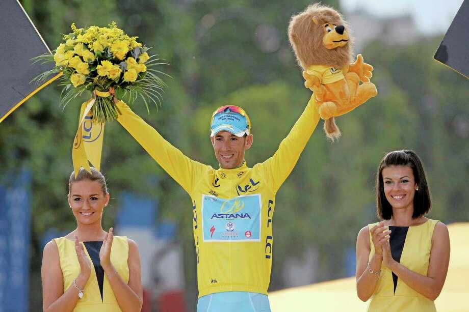 Tour de France winner Italy's Vincenzo Nibali celebrates on the podium in Paris on Sunday. Photo: Christophe Ena — The Associated Press   / AP
