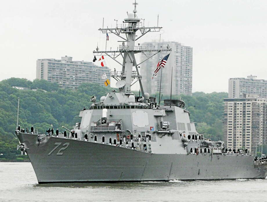 FILE - In this May 26, 2004 file photo, the USS Mahan, a guided-missile destroyer, moves up the Hudson River in New York during Fleet Week. A sailor was fatally shot aboard the USS Mahan at Naval Station Norfolk late Monday, March 24, 2014, and security forces killed a male civilian suspect, base spokeswoman Terri Davis said. (AP Photo/Ed Bailey, File) Photo: AP / A2004