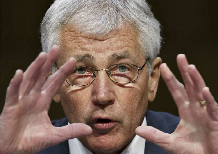 In this photo taken March 5, 2014, Defense Secretary Chuck Hagel appears at a Senate Armed Services Committee hearing on the Defense Department's budget request for fiscal year 2015, on Capitol Hill in Washington. Photo: AP Photo/J. Scott Applewhite/File   / AP