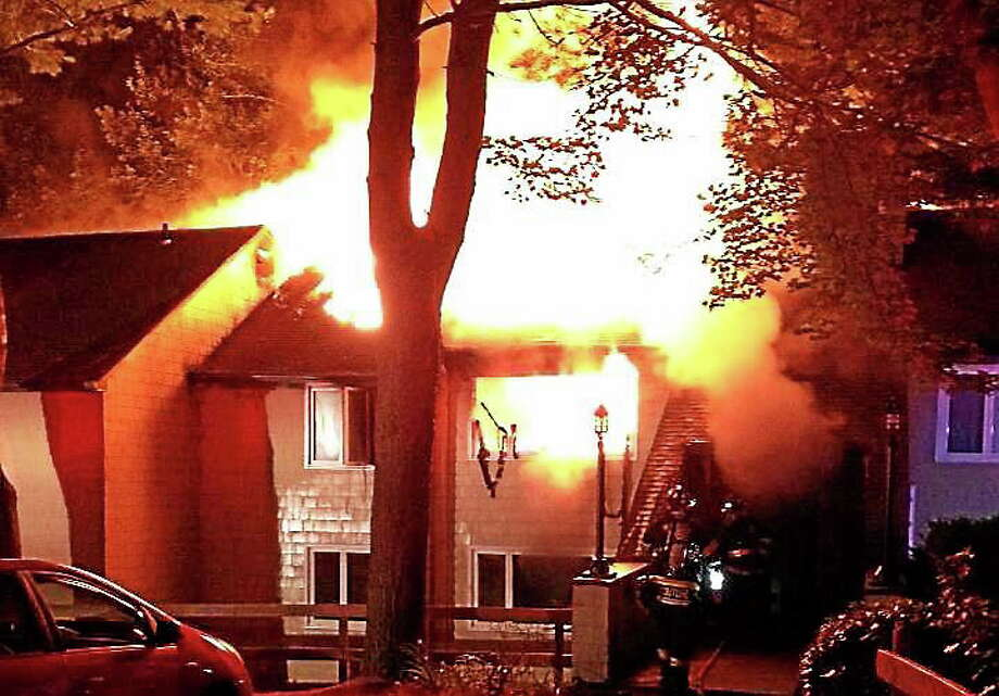 (Photo courtesy of Hamden Professional Firefighters Local 2687)   Hamden firefighters battled an early morning blaze at a residence on Evergreen Avenue on Sunday. An elderly woman was taken to the hospital after she jumped from a window to escape the flames. Photo: Journal Register Co.