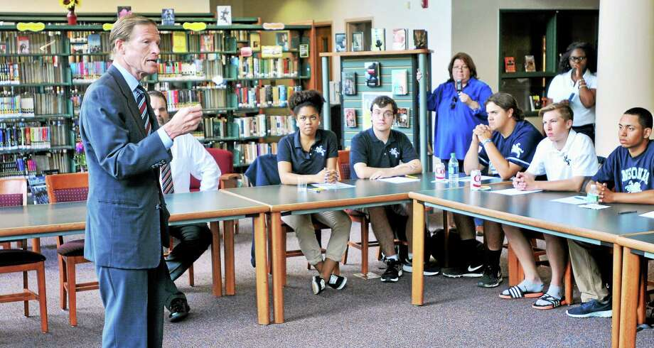 U.S. Sen. Richard Blumenthal, left speaks with seniors at Ansonia High School Tuesdat about college costs. Photo: Arnold Gold — New Haven Register