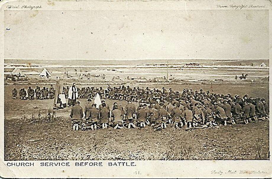 """""""Church Service Before Battle"""" depicts a group of World War I-era soldiers kneeling to pray at a church service before going into battle. Photo: RNS Photo/courtesy: Julie Maria Peace"""