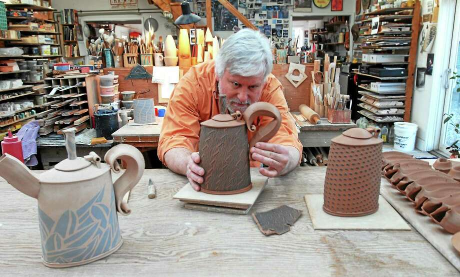 """3 ARTISTS IN IVORYTON: Potter Hayne Bayless of Ivoryton works on his signature teapots in his Sideways Studio as part of a Holiday Show and Sale that includes Mara Lavitt's textiles and Liz Pagano's mixed metal jewelry and monoprints. The show will be open noon to 5 p.m. Nov. 29-30 and Dec. 6-7 at 56A Pond Meadow Road in Ivoryton. Also included will be new lamps by Sideways & Askew, """"Where Paper and Clay Collide,"""" a collaboration by Pagano and Bayless. Photo: Mara Lavitt"""