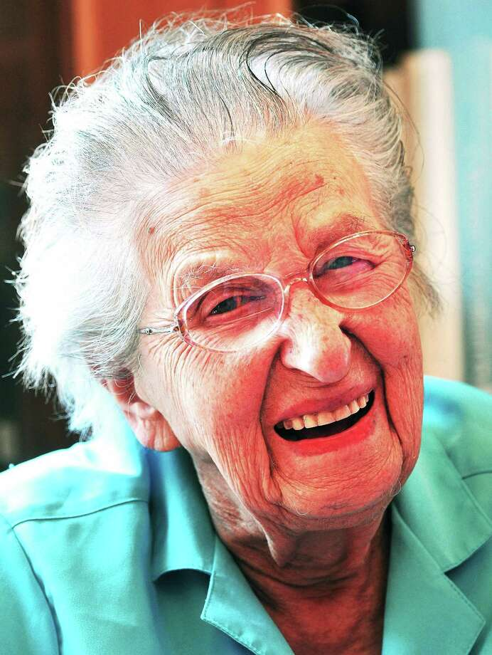 Peter Casolino ÇƒÓ Register  Edith Nettleton smiles during her 105th birthday party at the Guilford Library, where she still volunteers. pcasolino@newhavenregister.com Photo: Journal Register Co.