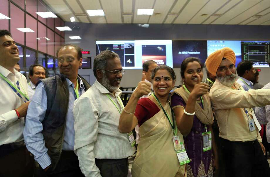 Indian Space Research Organisation scientists and officials cheer as they celebrate the success of Mars Orbiter Mission at their Telemetry, Tracking and Command Network complex in Bangalore, India, Wednesday, Sept. 24, 2014. India triumphed in its first interplanetary mission, placing a satellite into orbit around Mars on Wednesday morning and catapulting the country into an elite club of deep-space explorers. (AP Photo/Aijaz Rahi) Photo: AP / AP