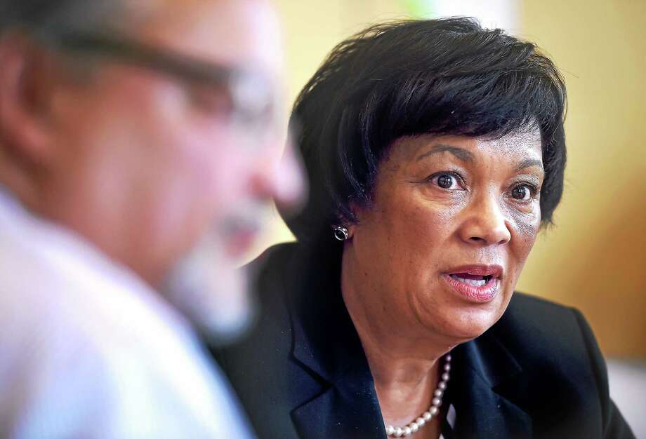 New Haven Mayor Toni Harp, right, meets with Chief of Staff Tomas Reyes, left, and other staff members in her office at City Hall in New Haven last week. Photo: Arnold Gold — New Haven Register