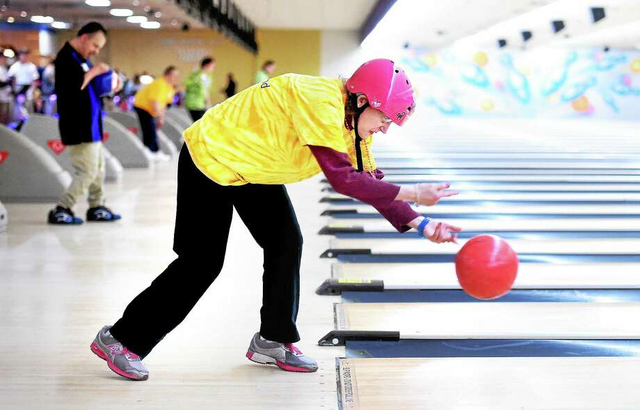 Lore Knorr of Brookfield bowls in the Special Olympics Connecticut 2014 Holiday Sports Classic at the AMF Lanes in Milford Saturday. Photo: Arnold Gold — New Haven Register