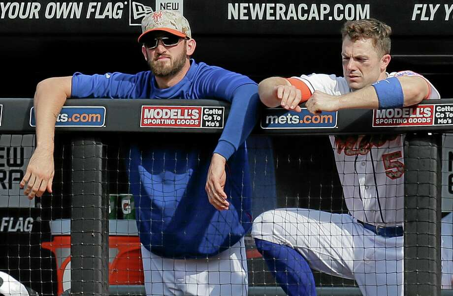 The Mets' Eric Campbell and David Wright (5) watch from the dugout during Monday's 5-3 loss to the Pittsburgh Pirates in New York. Photo: Julie Jacobson — The Associated Press   / AP
