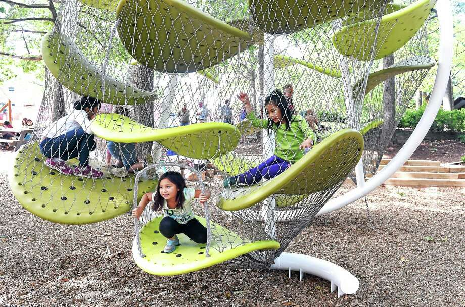 (Arnold Gold-New Haven Register)  Molly Romero (center), 7, emerges from one side of the Luckey Climber on the playground at Foote School in New Haven on 9/24/2014. Photo: Journal Register Co.
