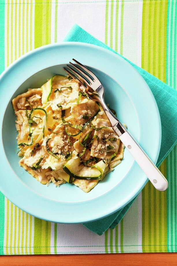 Spinach Ravioli With Zucchini Ribbons. Photo: Peter Ardito — EatingWell