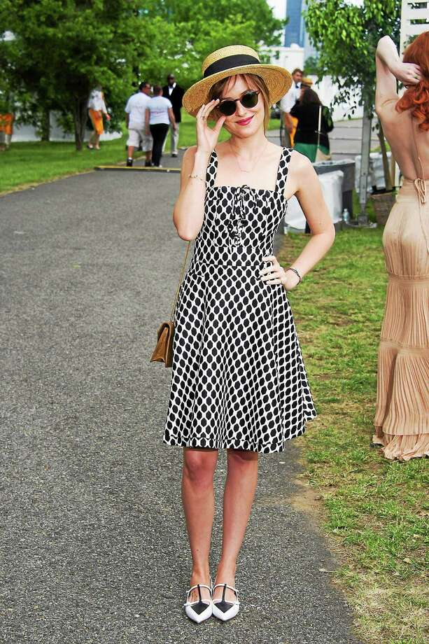 "In this file photo, ""Fifty Shades of Grey"" star Dakota Johnson attends the Veuve Clicquot Polo Classic on May 31, 2014 in Jersey City, N.J. Photo: Photo By Charles Sykes/Invision/AP   / Invision"