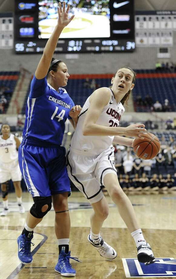 UConn's Breanna Stewart, right, dribbles around Creighton's Sydney Lamberty during the second half Sunday. Photo: Jessica Hill — The Associated Press   / FR125654 AP