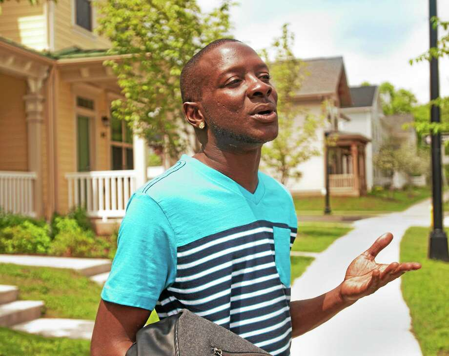 Carlos Wallace of New Haven talks about the removal of the fence between Hamden and the city's Brookside housing development. Photo: Melanie Stengel — New Haven Register