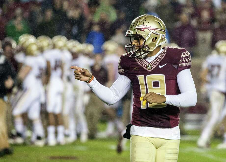 Florida State kicker Roberto Aguayo celebrates after kicking the game-winning field goal with three seconds left on Saturday. Photo: The Associated Press   / FR171224 AP