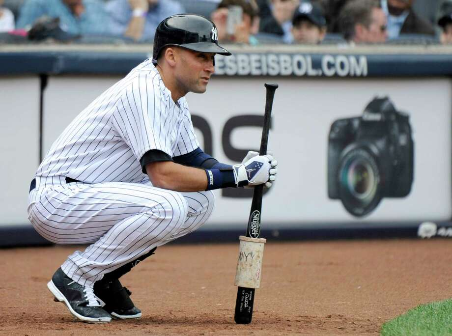 New York Yankees shortstop Derek Jeter waits to bat during the fifth inning of an eventual 9-5 loss to the Baltimore Orioles on Wednesday at Yankee Stadium. Photo: Bill Kostroun — The Associated Press   / FR51951 AP