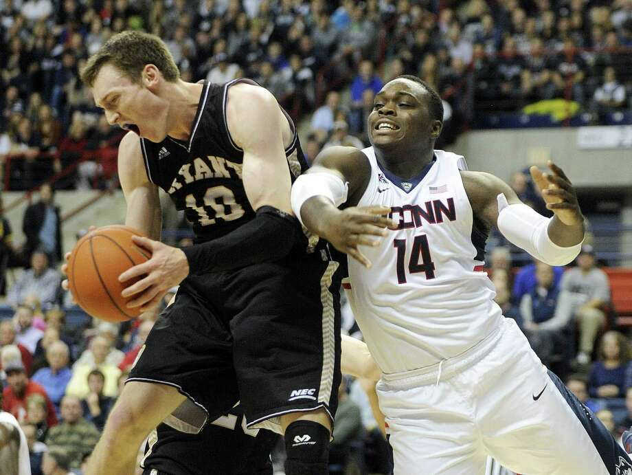 UConn's Rakim Lubin, right, was suspended for Sunday night's game due to a violation of team rules. Photo: The Associated Press File Photo   / FR153656 AP