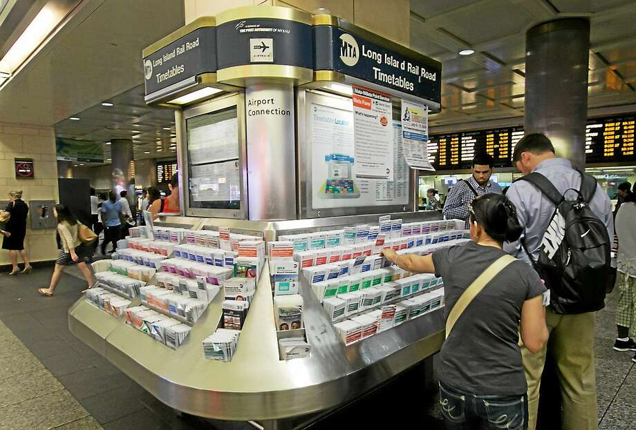 People choose their timetabled at in New York's Penn Station. Photo: AP Photo/Richard Drew   / AP