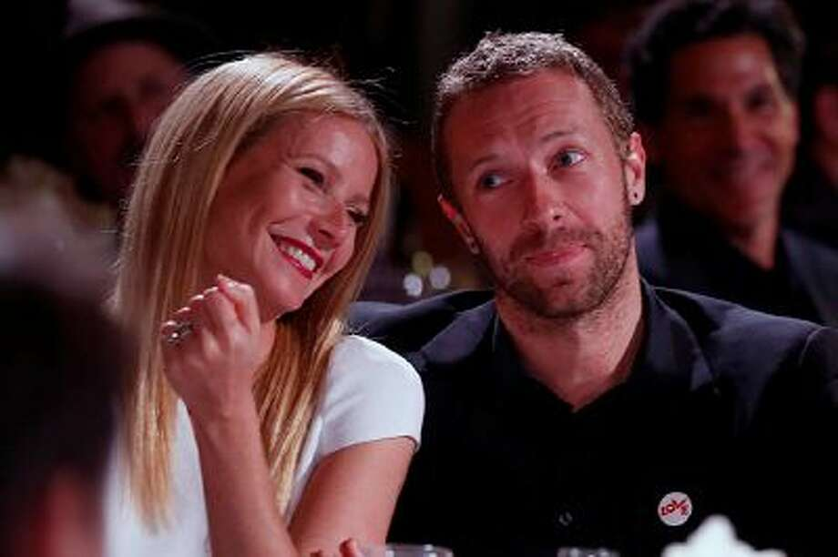 Gwyneth Paltrow, left, and Chris Martin are seen at the 3rd Annual Sean Penn & Friends HELP HAITI HOME Gala on Saturday, Jan. 11, 2014 at the Montage Hotel in Beverly Hills, Calif. (Photo by Colin Young-Wolff /Invision/AP) Photo: Colin Young-Wolff/Invision/AP / Invision2014