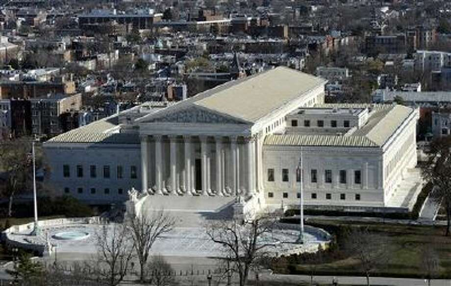 The Supreme Court is hearing arguments in a case that asks whether a victim of child pornography can seek millions of dollars from a defendant who had just two images of her on his computer. Photo: ASSOCIATED PRESS / A2013