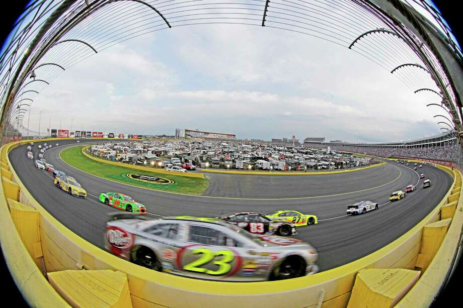 In this photo taken with a fisheye lens drivers including Alex Bowman (23) race out of Turn 3 during the Coca-Cola 600 at Charlotte Motor Speedway on Sunday. Photo: Chuck Burton — The Associated Press   / AP