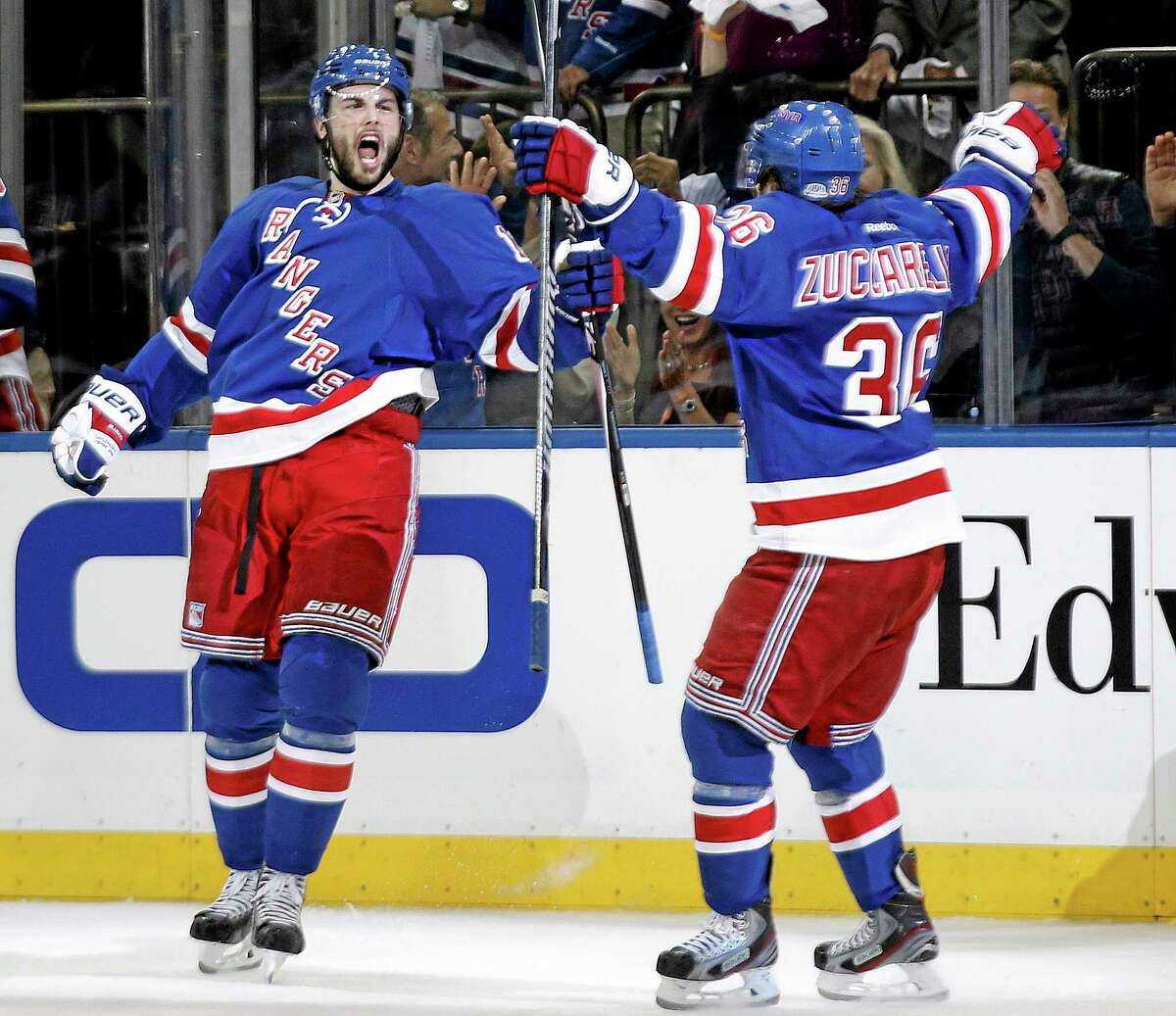 Rangers center Derick Brassard celebrates with right wing Mats Zuccarello (36) after scoring against the Canadiens during the second period Sunday night.