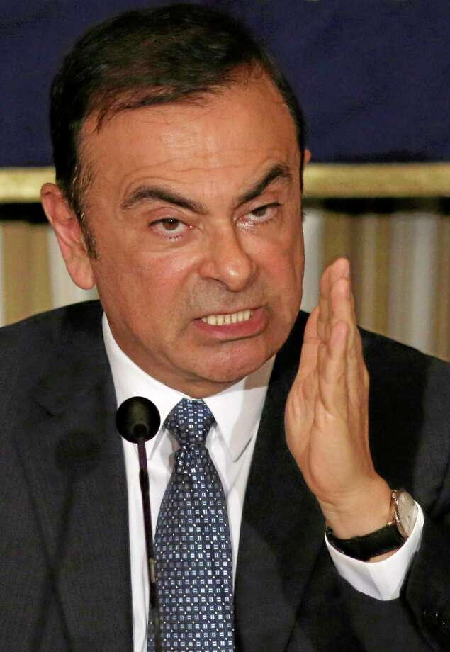 Nissan Chief Executive Carlos Ghosn gestures while speaking during a press conference at Foreign Correspondents' Club of Japan in Tokyo, Thursday, July 17, 2014. Ghosn, who has long made a point of promoting women to management positions, said the Japanese Prime Minister Shinzo Abe's plan to boost female bosses to 30 percent by 2020 is too ambitious. The participation of women in Japan's workforce is very low by developed nation standards. Women make up 2.9 percent of manager-level and higher positions at Japanese companies employing 5,000 or more people. (AP Photo/Eugene Hoshiko) Photo: AP / AP