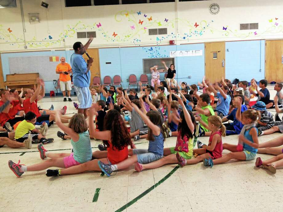 """Children dance to DJ Casper's song, """"Oops Upside Your Head,"""" in Thursday in North Branford. Casper, creator of the """"Cha Cha Slide,"""" said he would use footage from the performance in one of his music videos. Photo: Kristin Stoller — New Haven Register"""
