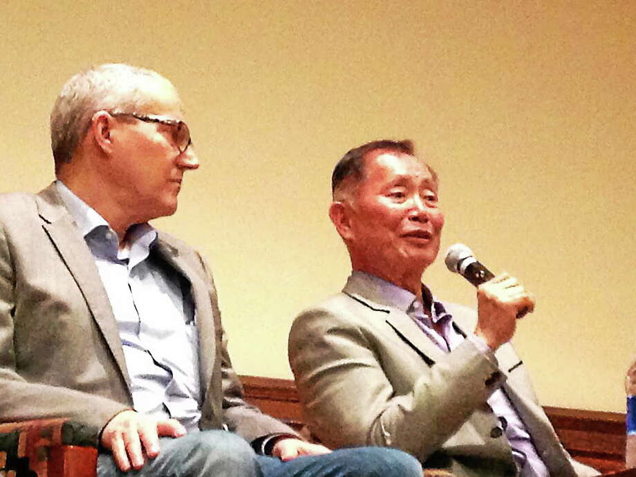 """Actor and activist George Takei, right, speaks during a panel discussion following a screening of """"To Be Takei,"""" a documentary on his life, at the Whitney Humanities Center at Yale University Friday night. At left is Takei's husband, Brad Altman. Photo: Photo By Ben Bartenstein"""