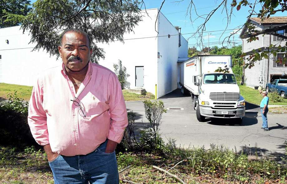 A Truck Pulls Into White X2019 S Plumbing Supplies Warehouse Across From Louis Horner