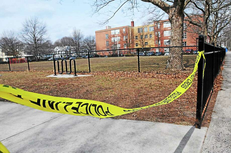 Police tape can be seen Tuesday near Lincoln-Basset Elementary School on Butler Street between Ivy and Lilac streets in New Haven. Photo: Peter Hvizdak — New Haven Register
