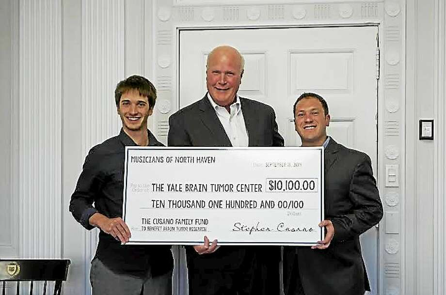 Stephen Cusano, left, and his brother Christopher Cusano, right, present a check to Yale Brain Tumor Center surgeon Dr. Joseph Piepmeier. Photo: (Contributed Photo)