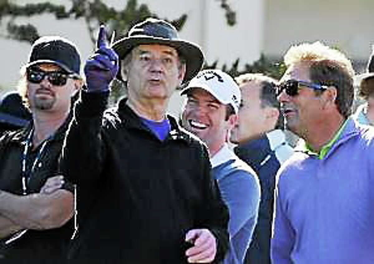 Bill Murray holds court on the 1st tee as actor Lucas Black, center, and singer Huey Lewis look on during the 3M Celebrity Challenge at Pebble Beach Golf Links in Pebble Beach Wednesday Feb. 8, 2012.