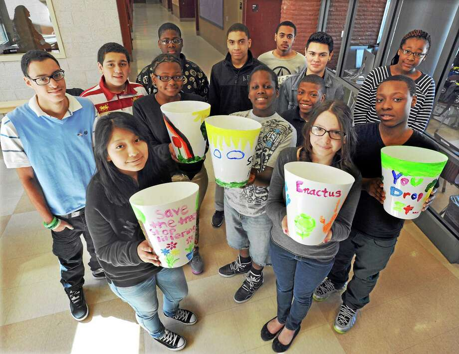 Quinnipiac University students have been working with students at Bishop Woods School in New Haven learning some entrepreneurship. These 7th and 8th grade students will be raising awareness about trash with their hand-decorated trash cans, and raising money as well.  mlavitt@newhavenregister.com Photo: (Mara Lavitt - New Haven Register)   March 21, 2014 New Haven   / Mara Lavitt