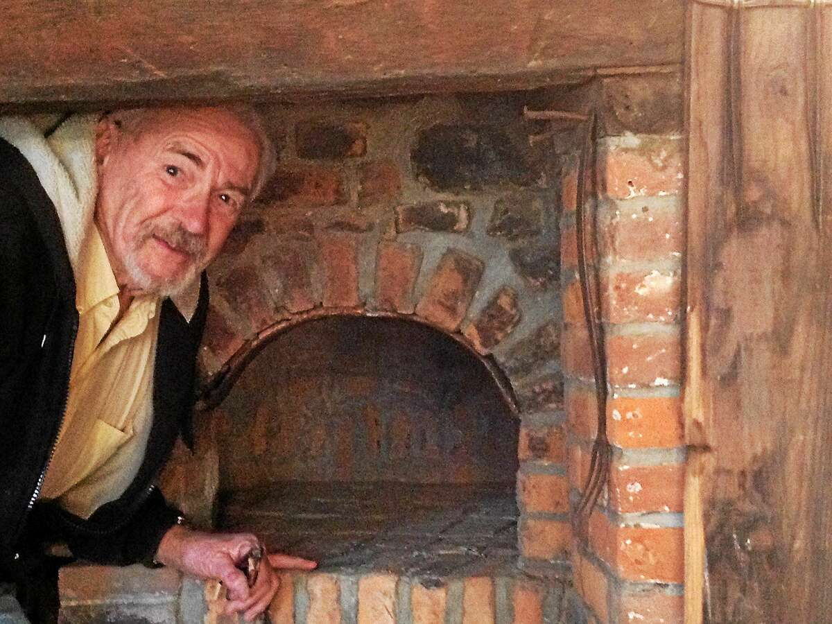 PAMELA MCLOUGHLIN — NEW HAVEN REGISTER Mason Joe Carney figured out how to make this beehive oven work at the historic Nathan Bryan-William Andrew House in Orange.