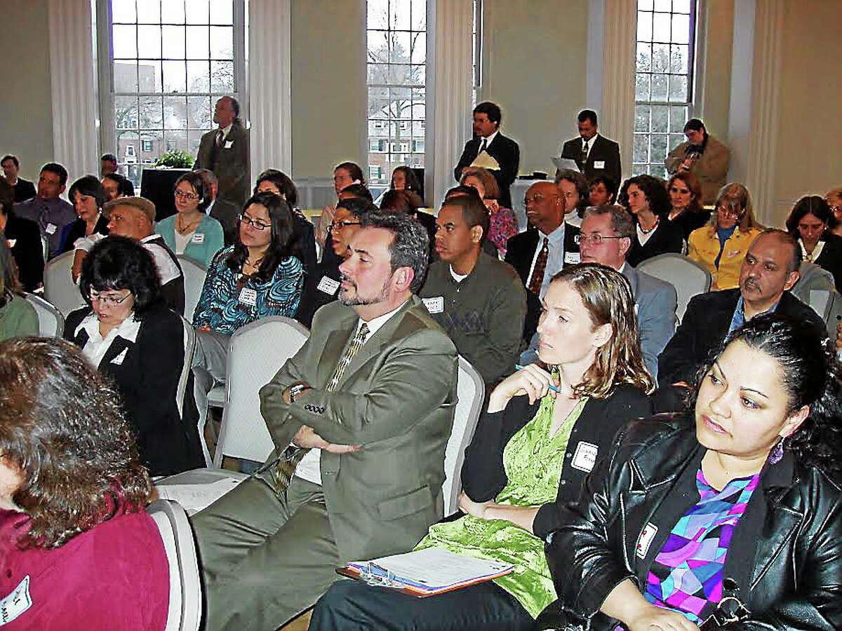Crowds listen at a past Progreso Latino Fund forum (contributed).