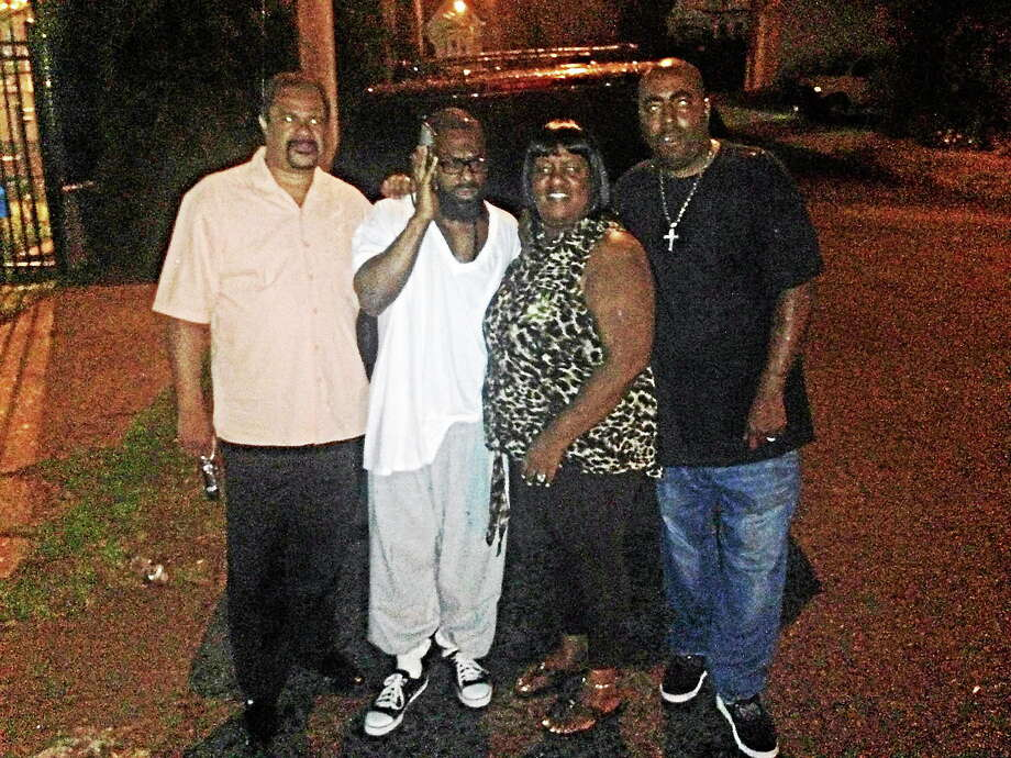 From left, investigator Dawud Moss; Vernon Horn; Horn's cousin, Michelle Ledbetter; and Ledbetter's husband, Sam, outside the Bridgeport Correctional Center after Horn's release Wednesday night. Photo: CONTRIBUTED PHOTO - Tequan Ledbetter