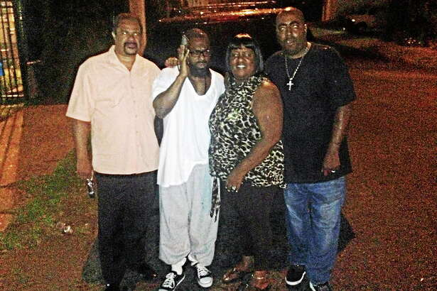 From left, investigator Dawud Moss; Vernon Horn; Horn's cousin, Michelle Ledbetter; and Ledbetter's husband, Sam, outside the Bridgeport Correctional Center after Horn's release Wednesday night.