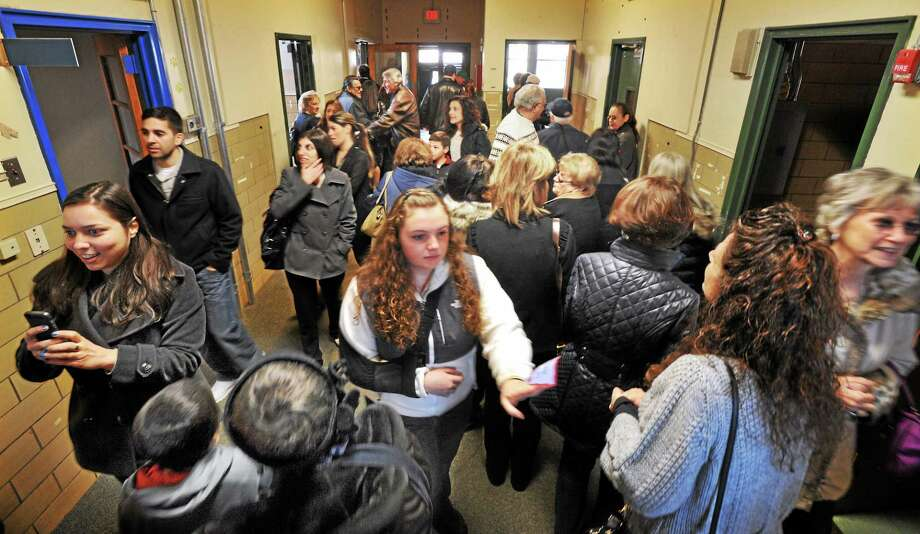 Former students of St. Michael's School in Wooster Square, New Haven, and their families, took a last tour of the school before it is to be sold.  mlavitt@newhavenregister.com Photo: (Mara Lavitt - New Haven Register)    / Mara Lavitt