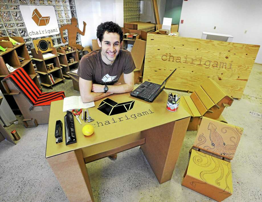 Zachary Rotholz of New Haven is expanding his Chairigami business in New Haven, courtesy of a Kickstarter campaign. Rotholz is at one of his company's standing desks.  mlavitt@newhavenregister.com Photo: (Mara Lavitt - New Haven Register)    / Mara Lavitt