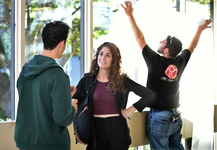 """Victoria Negri, an actress, writer, director and Orange native, discusses the next scene while the film crew adjusts the lighting during the filming of """"Gold Star"""" Monday at Gaylord Hospital in Wallingford. Photo: Catherine Avalone — New Haven Register    / The Middletown Press"""