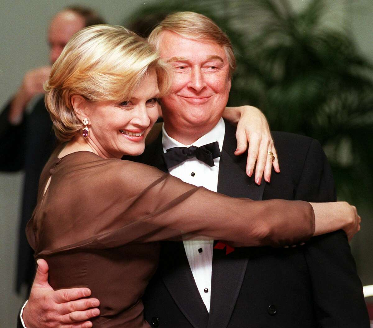FILE - Television journalist Diane Sawyer and her husband, film director Mike Nichols, pose together at the Academy of Television Arts & Sciences' 13th Annual Hall of Fame induction ceremonies, in this Nov. 1, 1997, file photo taken in the North Hollywood section of Los Angeles. ABC News confirms Mike Nichols, director and husband of Diane Sawyer, died Nov. 19, 2014. He was 83.