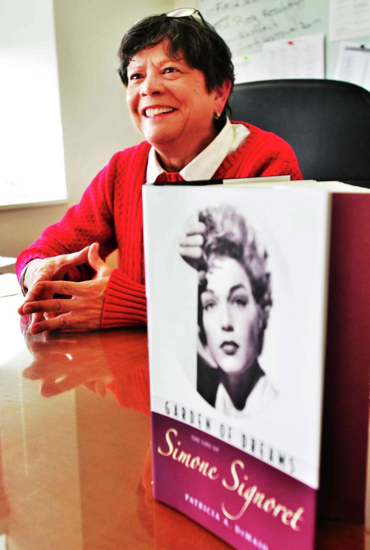 (Melanie Stengel ó New Haven Register) New Haven Public School grant coordinator, Pat DeMaio, has gotten her first book published 1/15. it is a biography of Simone Signoret.