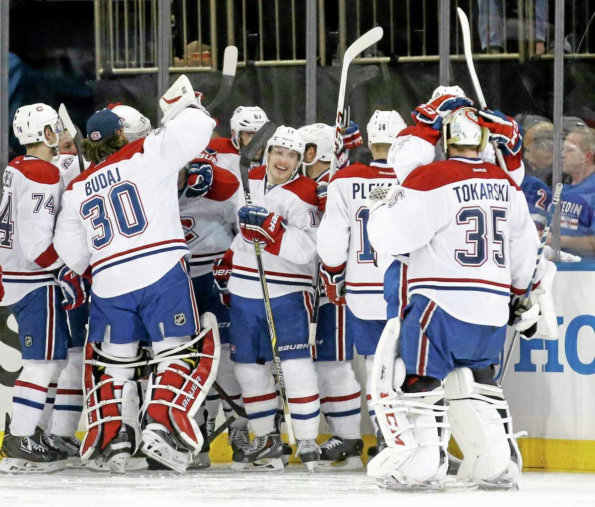 The Montreal Canadiens celebrate after defeating the New York Rangers 3-2 in overtime in Game 3 of the Stanley Cup playoffs Eastern Conference finals.