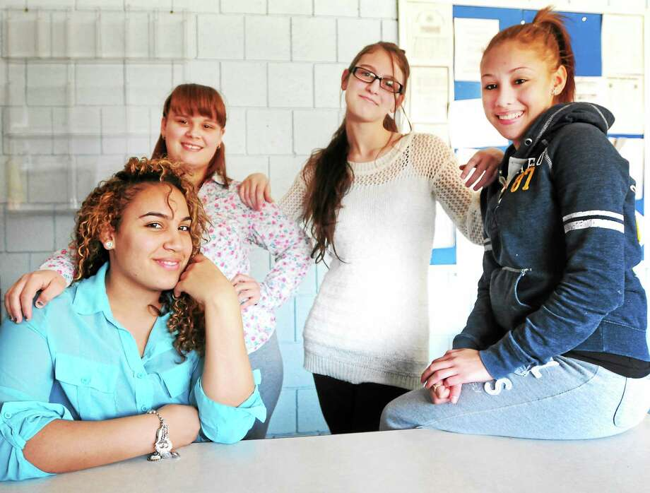 Laisha Colazo, 19, Mercedez Dillon, 16, Aleah Gambino, 17, and Stephanie Moldonado, 17, are students at Crosby High School in Waterbury and teenage mothers who are part of the Support For Pregnant And Parenting Teens (SPPT) program. Photo: Peter Hvizdak — New Haven Register / ©Peter Hvizdak /  New Haven Register