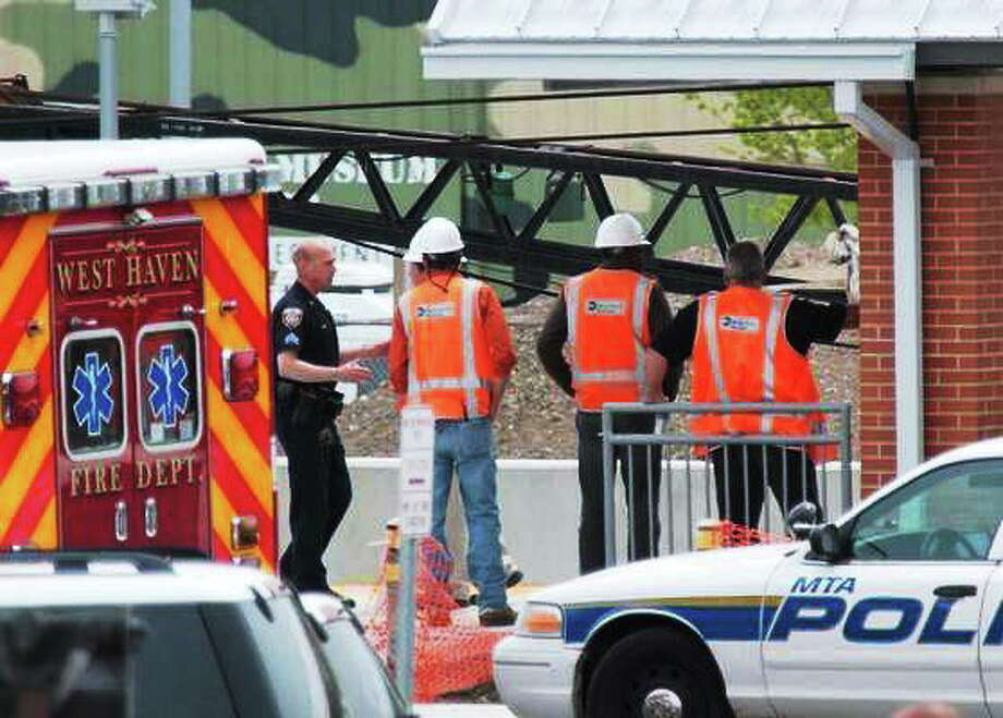 West Haven and Metro-North police investigate the scene at the West Haven train station, where a worker was killed by a train in May 2013. Photo: Peter Casolino — New Haven Register