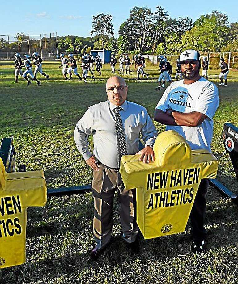 Bill Oliver, left, and Juan Gardner, parents of Hillhouse High School football players who are disturbed that the school's football will have no home games this year because of dangerous chemicals found on Bowen Field in New Haven. Wednesday, September 17, 2014. Photo: (Peter Hvizdak — New Haven Register)