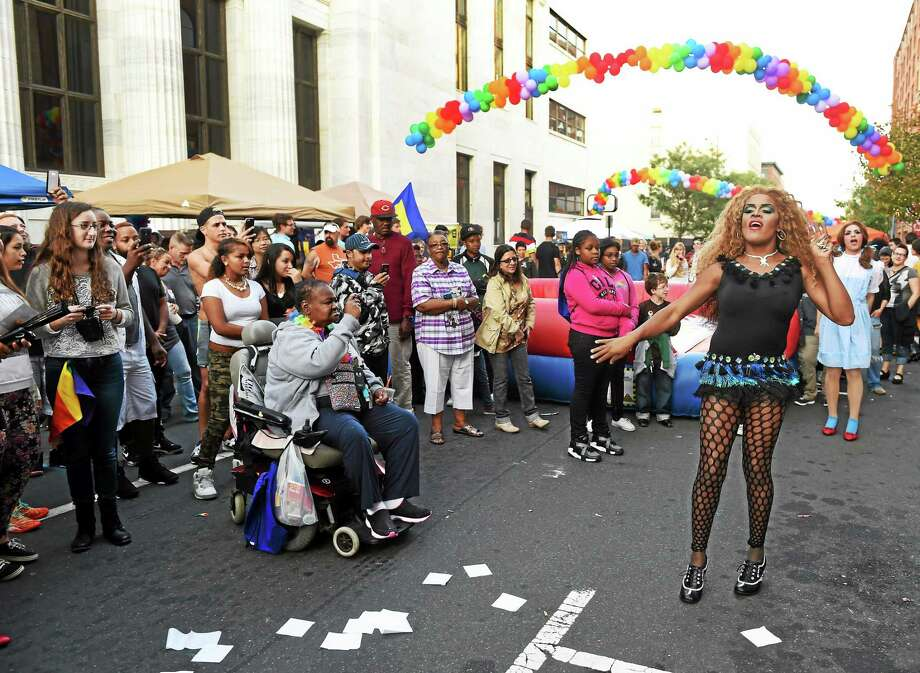 Malaya Love of New Haven, who wished to be identified by her stage name, performs a drag show during the New Haven LGBTQ Pride weekend event on Crown Street between State and Church Streets in New Haven Saturday, September 20, 2014  that included, entertainment, vendors, food trucks and a Dunk-A-Queen booth. Photo: (Peter Hvizdak — New Haven Register)   / ©2014 Peter Hvizdak