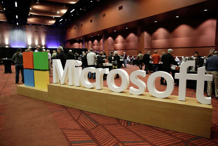 The Microsoft logo is pictured at the Microsoft Annual Shareholders Meeting in Bellevue, Washington on November 30, 2016.  / AFP / Jason Redmond        (Photo credit should read JASON REDMOND/AFP/Getty Images)
