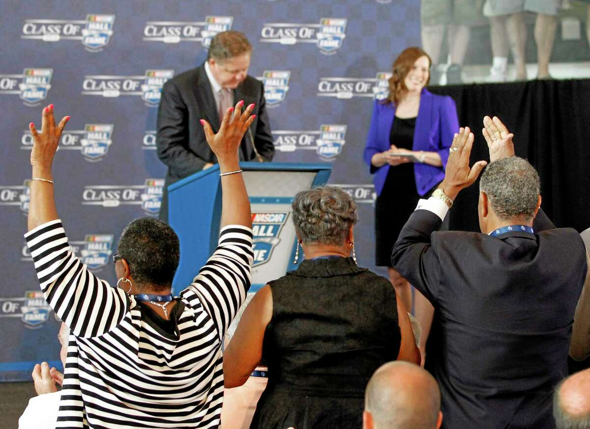 Family members of driver Wendell Scott react after Scott was named as one of five inductees into the NASCAR Hall of Fame class of 2015 in Charlotte, North Carolina, on Wednesday.