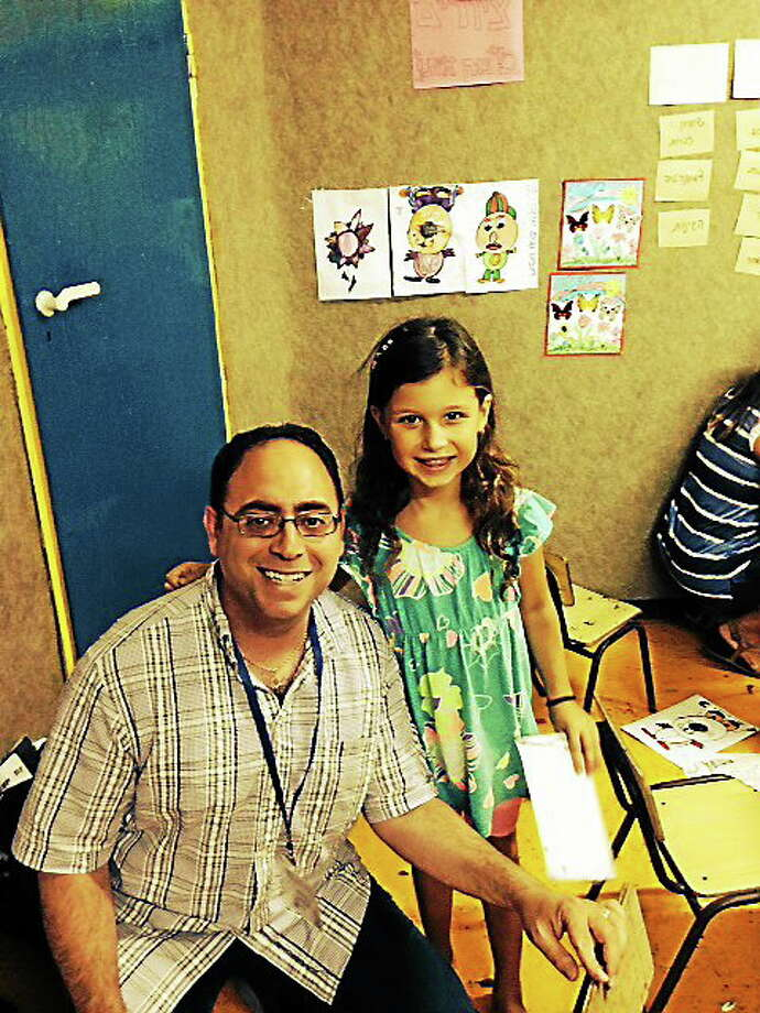 Rabbi Jeremy Wiederhorn with a child from Ashkelon whose summer camp experience has been moved inside to a bomb shelter. Photo: Contributed Photo